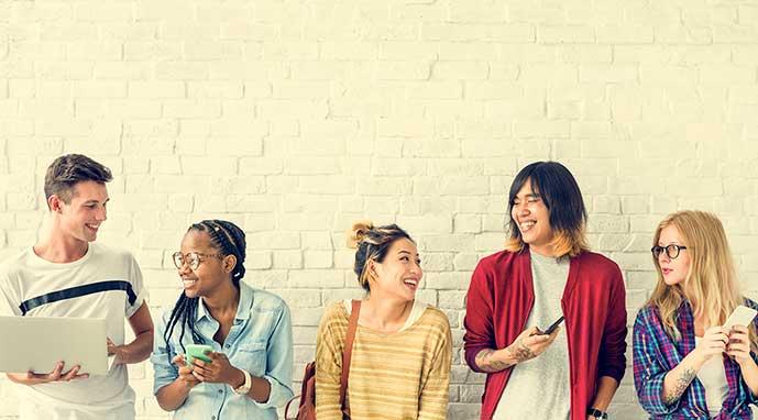 several kids young adults using social media